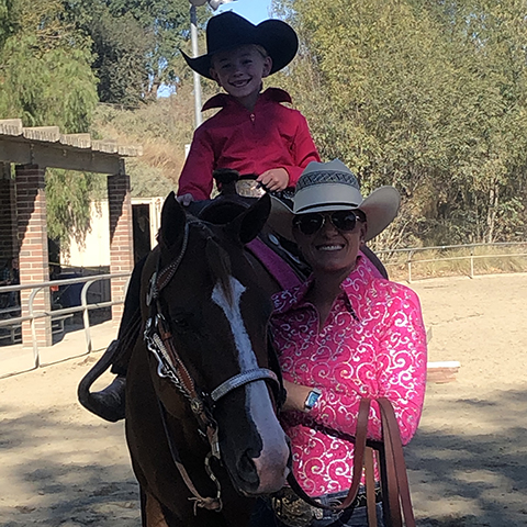Happy mother and daughter equestrians